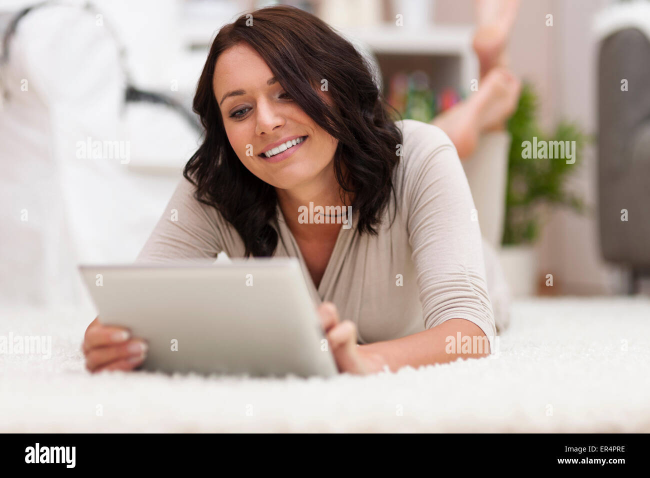 I have to check something on my digital tablet. Debica, Poland - Stock Image