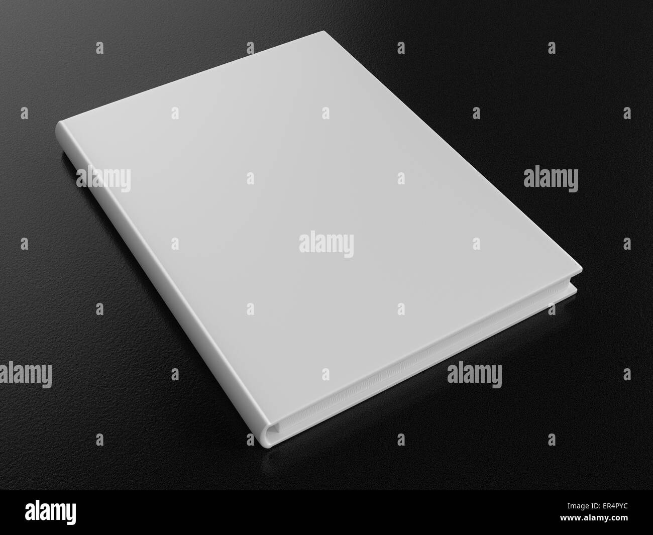 Single blank white book on a dark rough background. - Stock Image