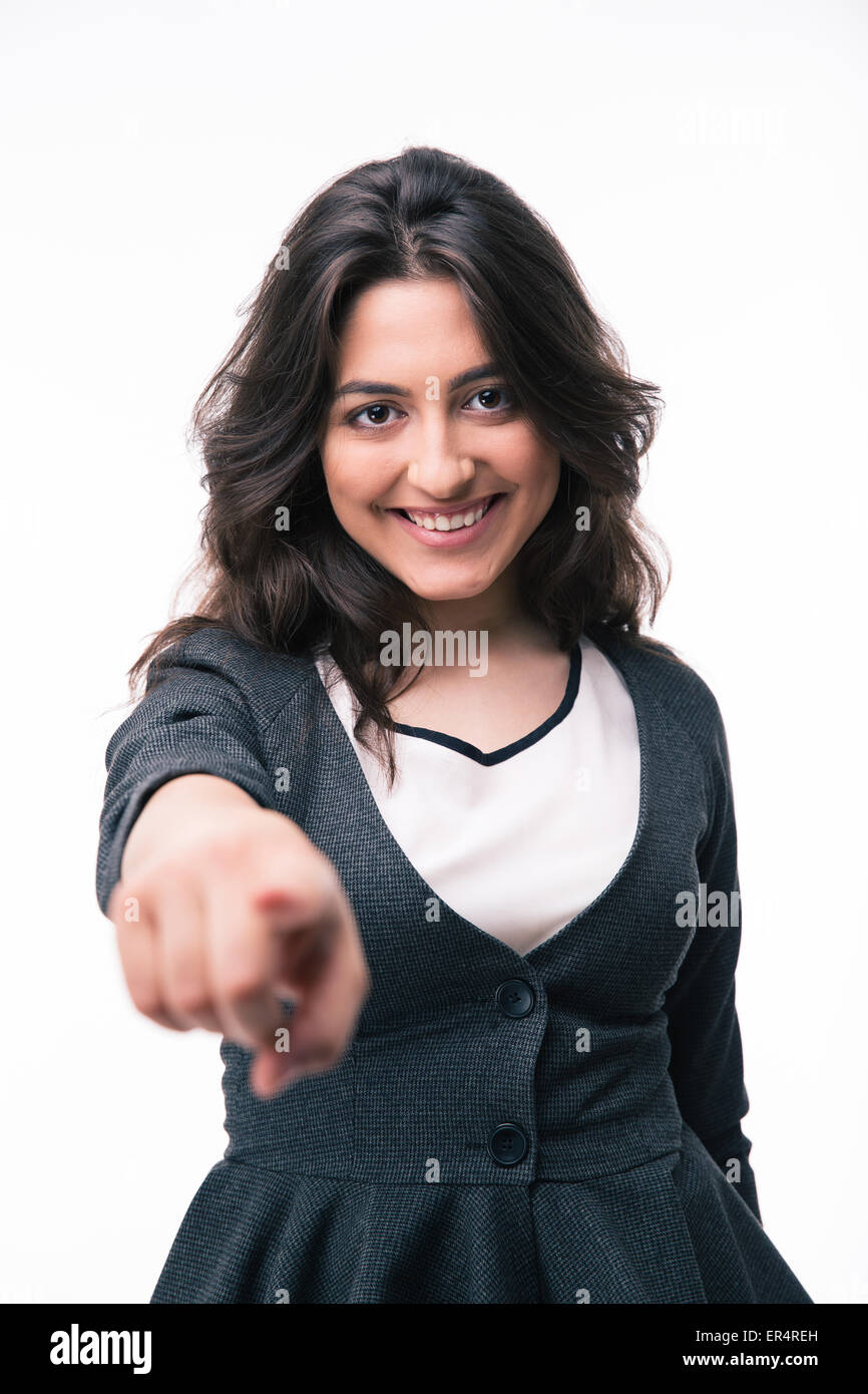 Happy businesswoman pointing finger on camera over white background - Stock Image