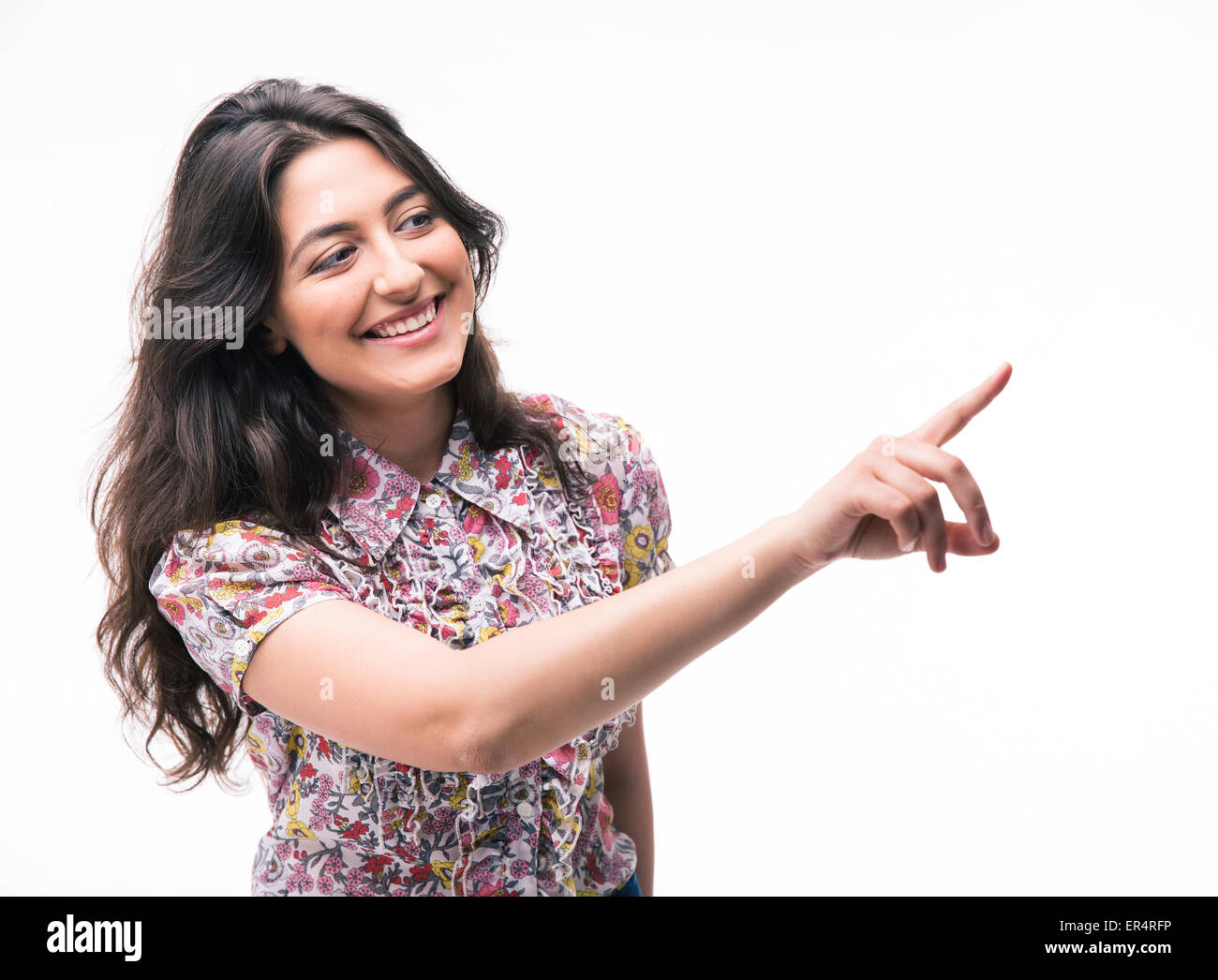 Happy woman pointing finger away isolated on a white background - Stock Image