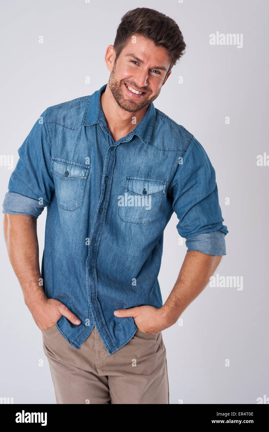 He likes denim shirts and he looks trendy. Debica, Poland - Stock Image