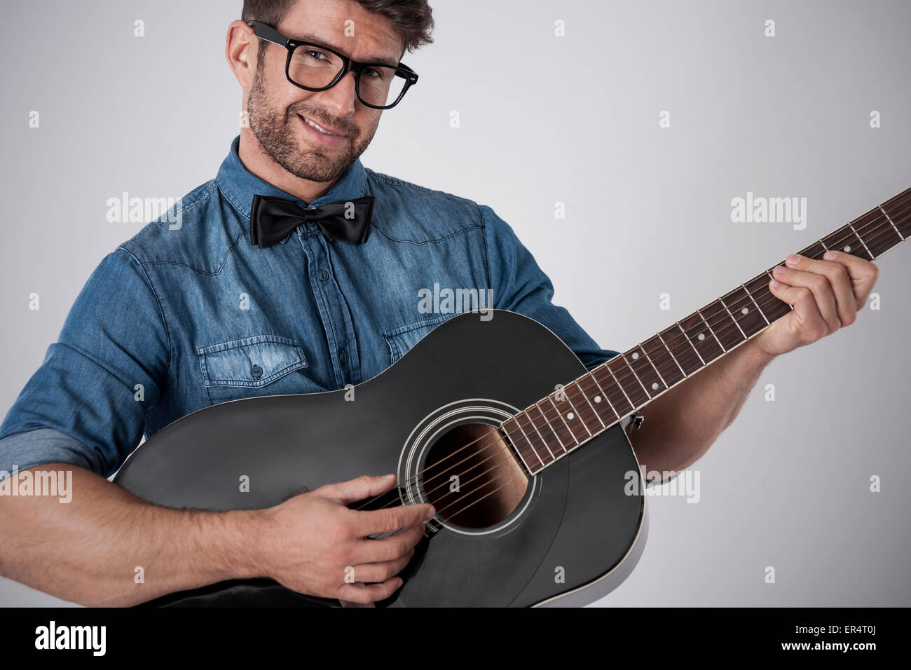 Playing a guitar is a symbol of a romantic man. Debica, Poland - Stock Image