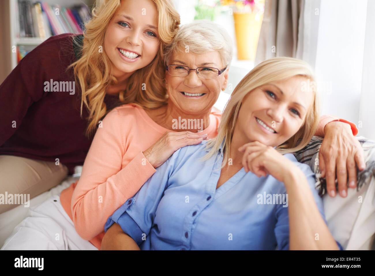 Portrait of a lovely family of women in living room. Debica, Poland - Stock Image