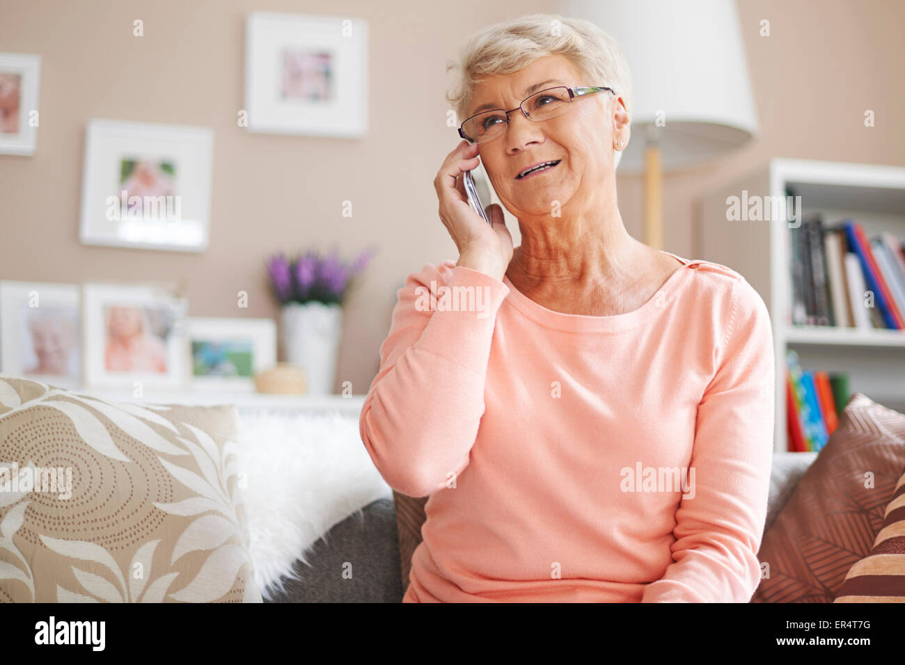 Senior woman keeping up to date with contemporary technology. Debica, Poland - Stock Image