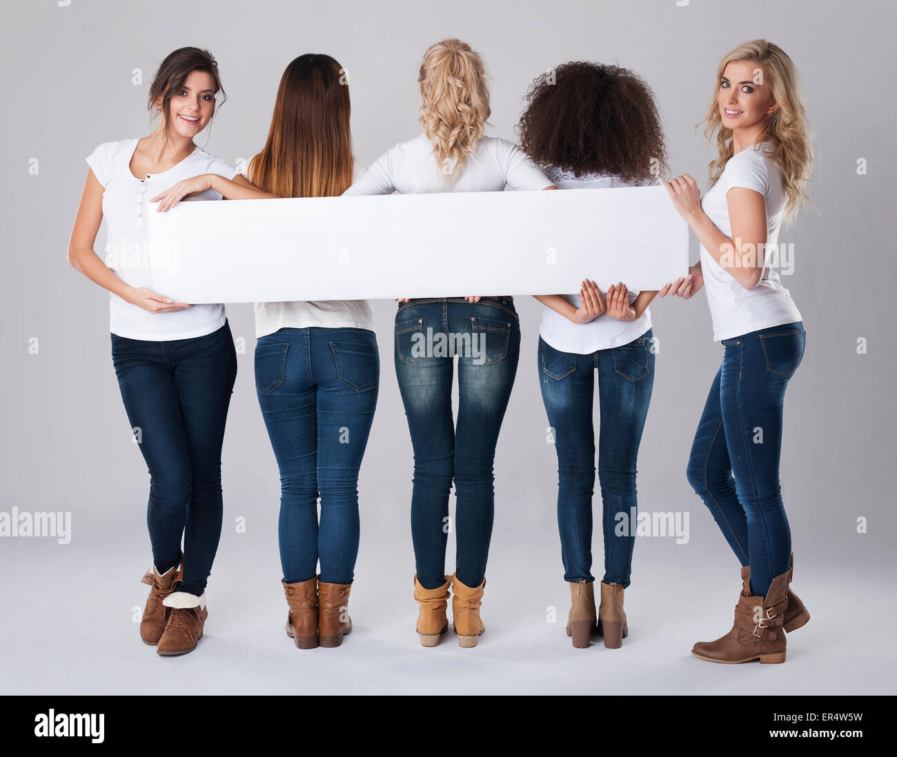 Girls with long white and empty banner. Debica, Poland - Stock Image