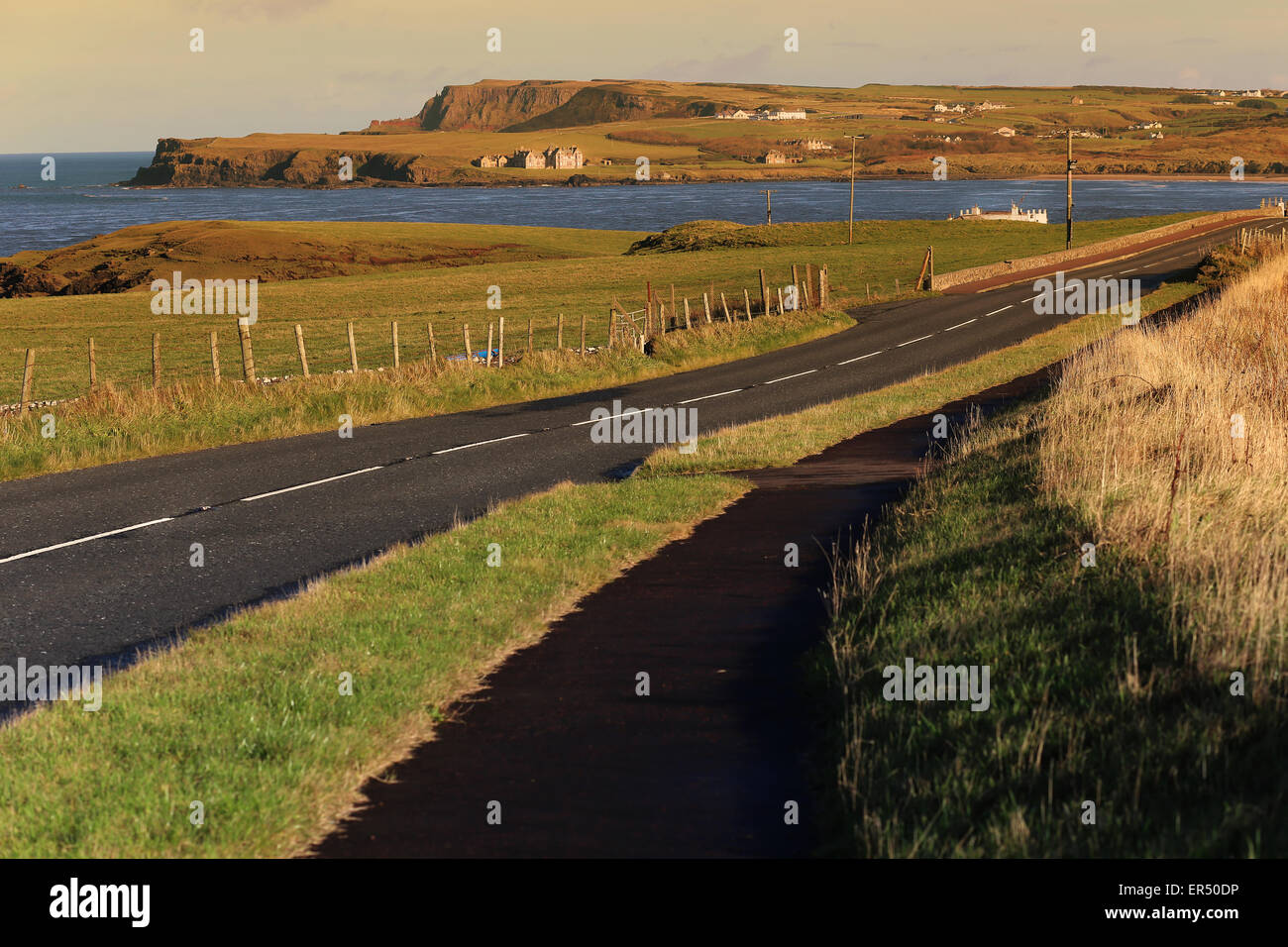 Causeway Coastal Route near Bushmills.County Antrim,Northern Ireland,UK,Europe.On background:Giant's Causeway Stock Photo