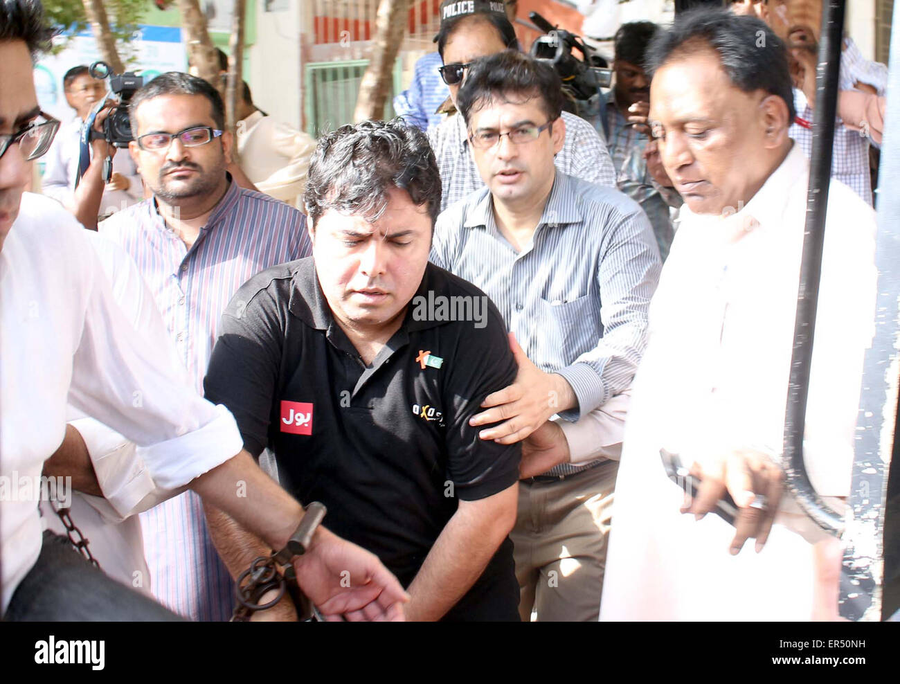 CEO of Axact, Shoaib Sheikh is being escorting by FIA staffs as he  presented in front of District South Special Court, on Wednesday, May 27,  2015.