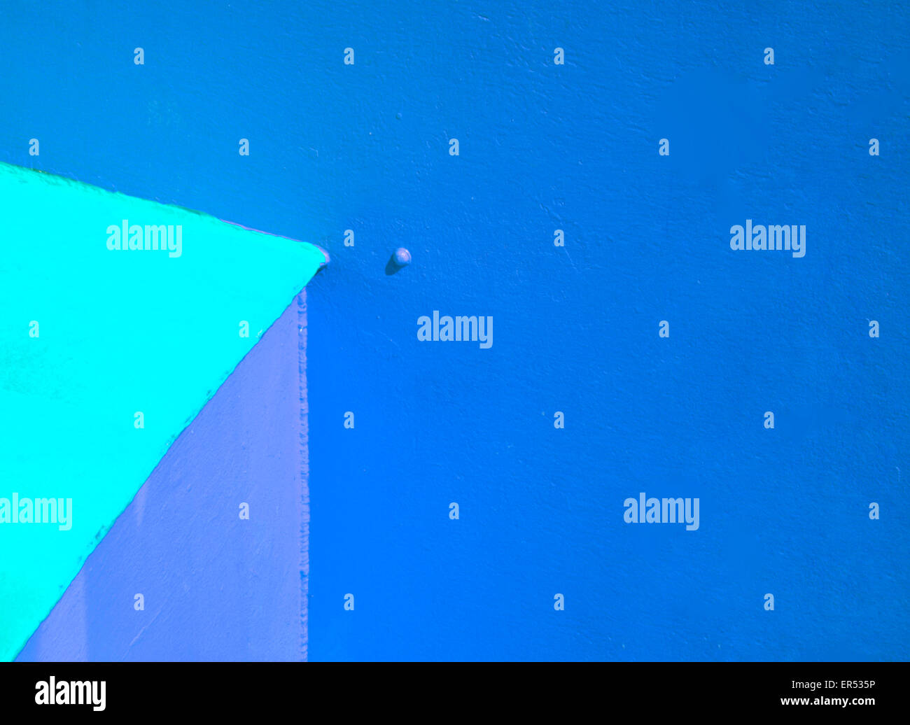 An abstract design in colour and angles based on the blue end of the spectrum. - Stock Image