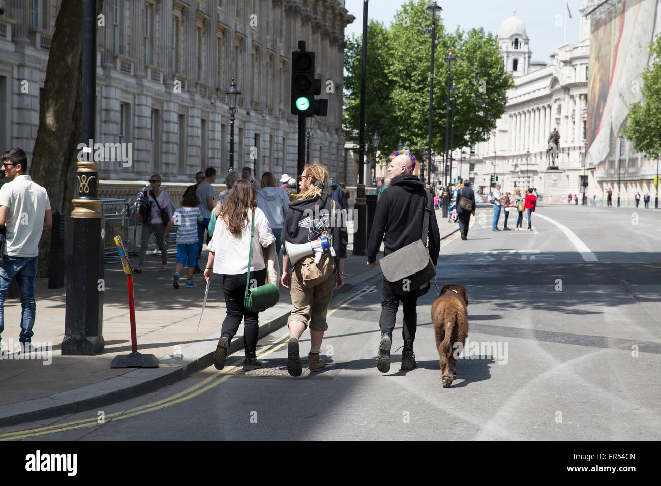 London,UK,27th May 2015,Visitors walk up Whitehall with a loud hailer in Londo Credit: Keith Larby/Alamy Live News Stock Photo