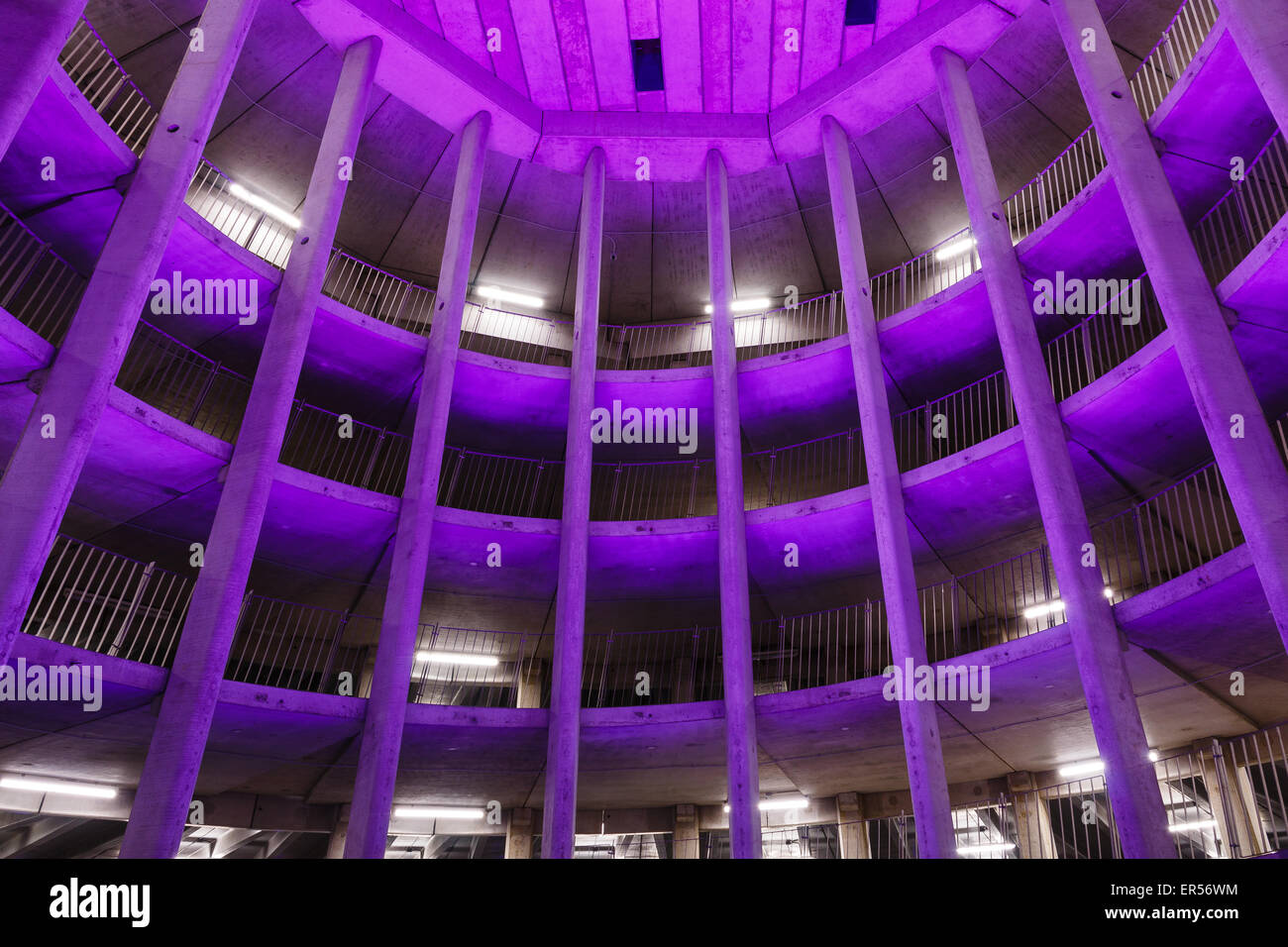 Spiral parking garage  Ossenmarkt in Groningen, The Netherlands. Purple color coming from the ever changing lighting system. Stock Photo