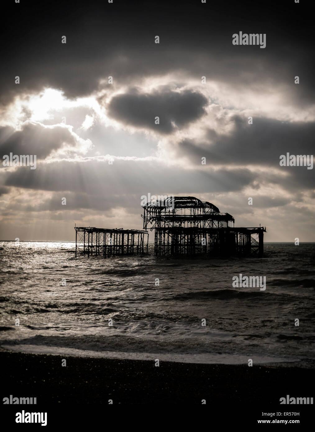 Brighton pier at sunset - Stock Image