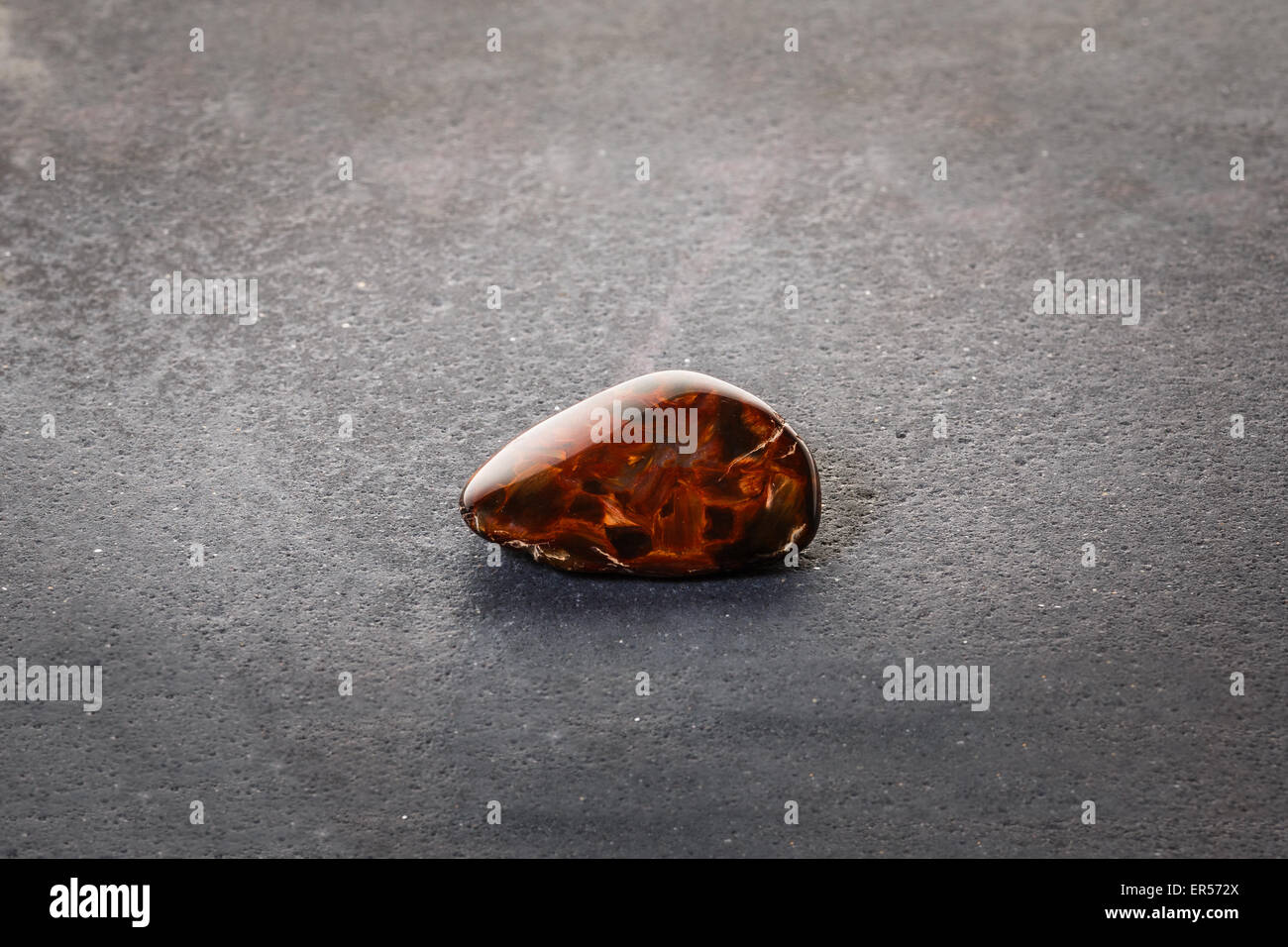 piece of pietersite originating from namibia africa on stone surface