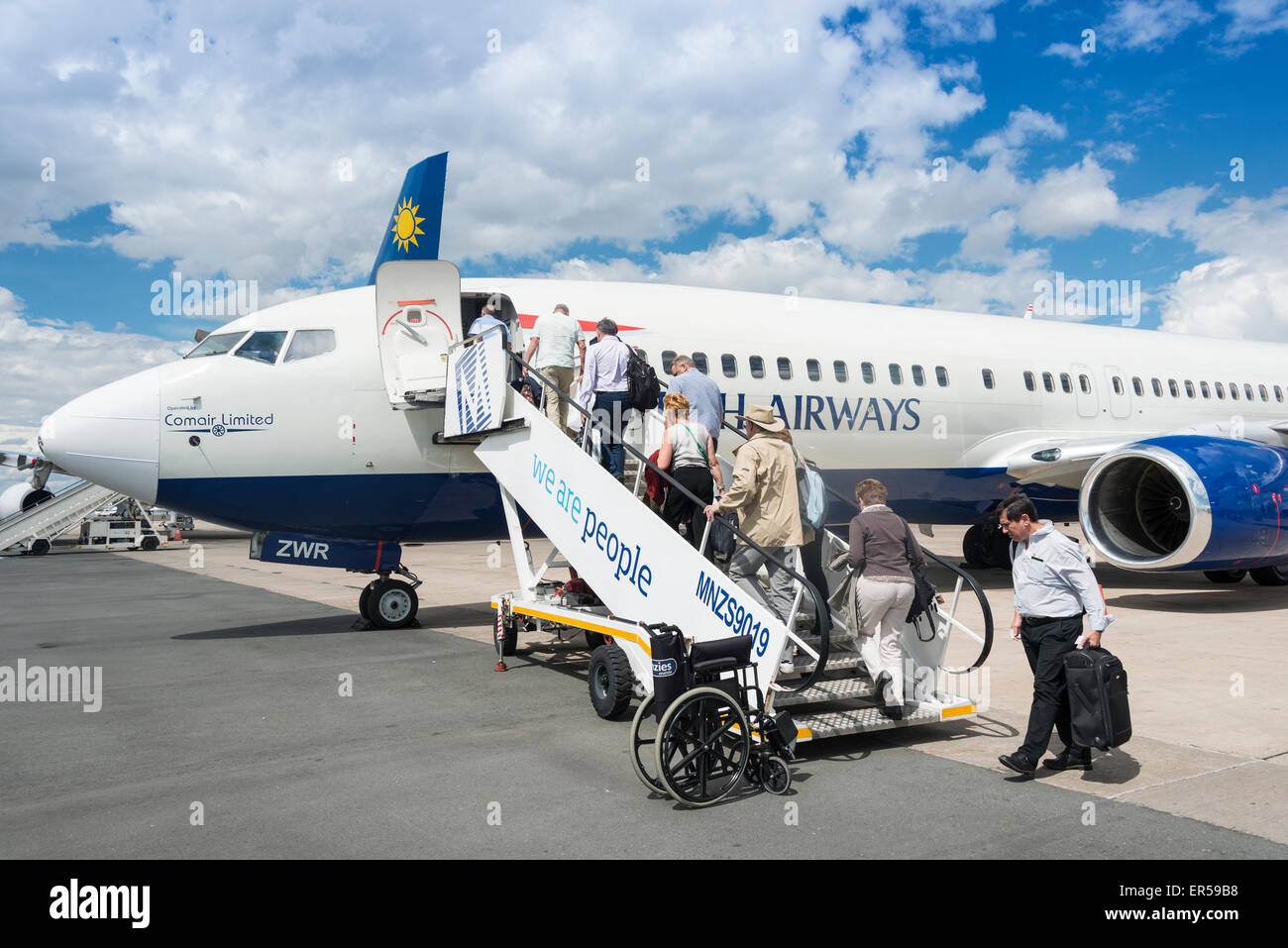 Passengers boarding British Airways (Comair) Boeing 737 at Hosea Kutako International Airport, Windhoek, Republic - Stock Image