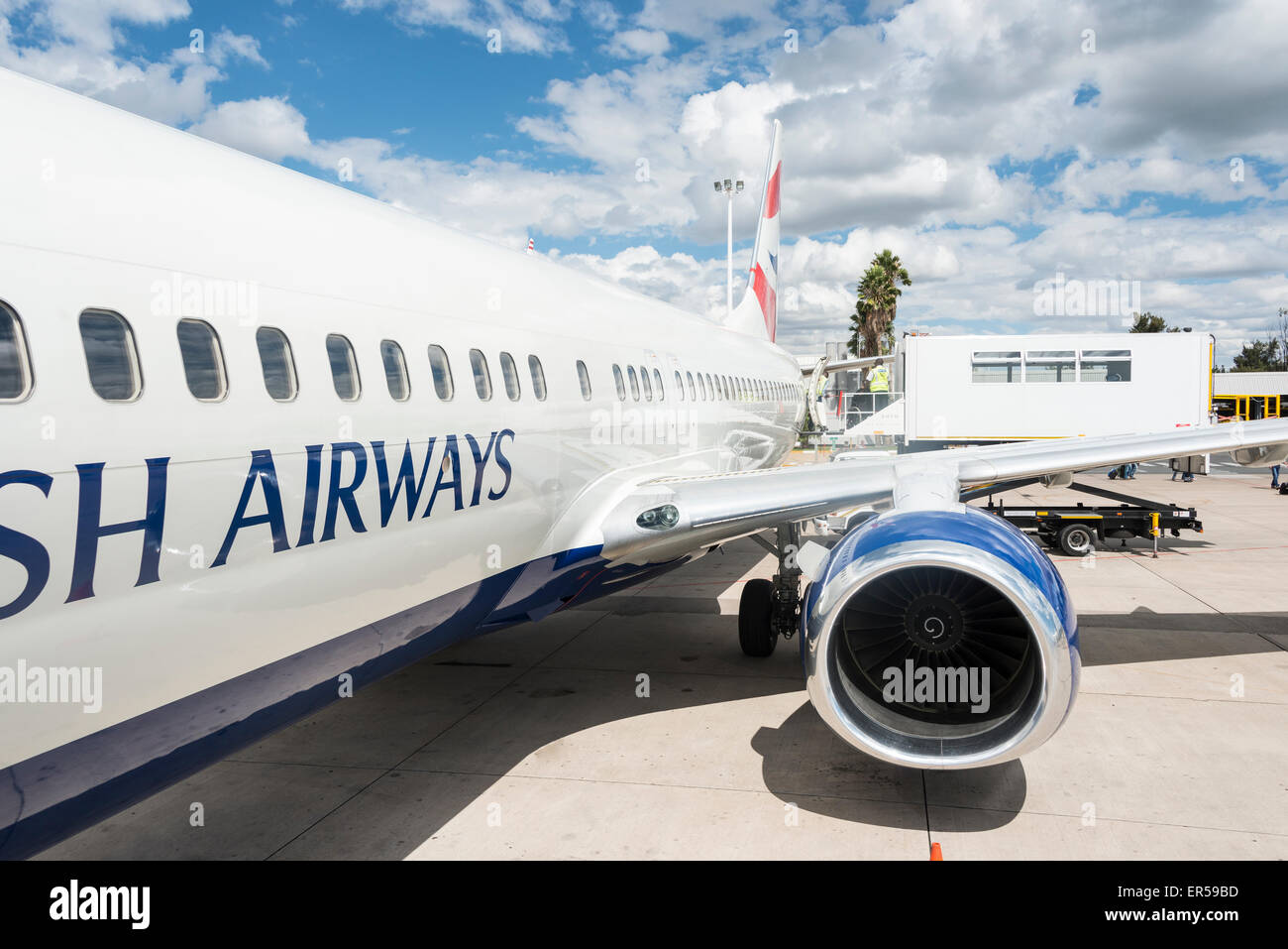 Loading disabled passenger on British Airways (Comair) Boeing 737 at Hosea Kutako International Airport, Windhoek, - Stock Image