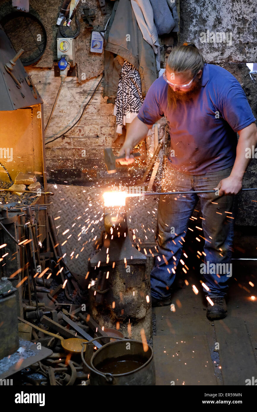 a blacksmith at work in his forge in southsea england uk - Stock Image