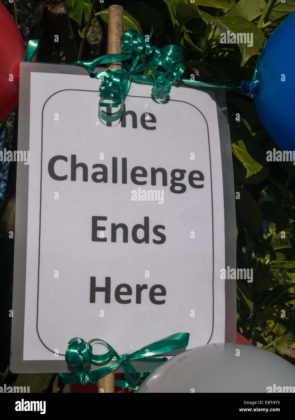 Sign saying The Challenge Ends Here - Stock Image