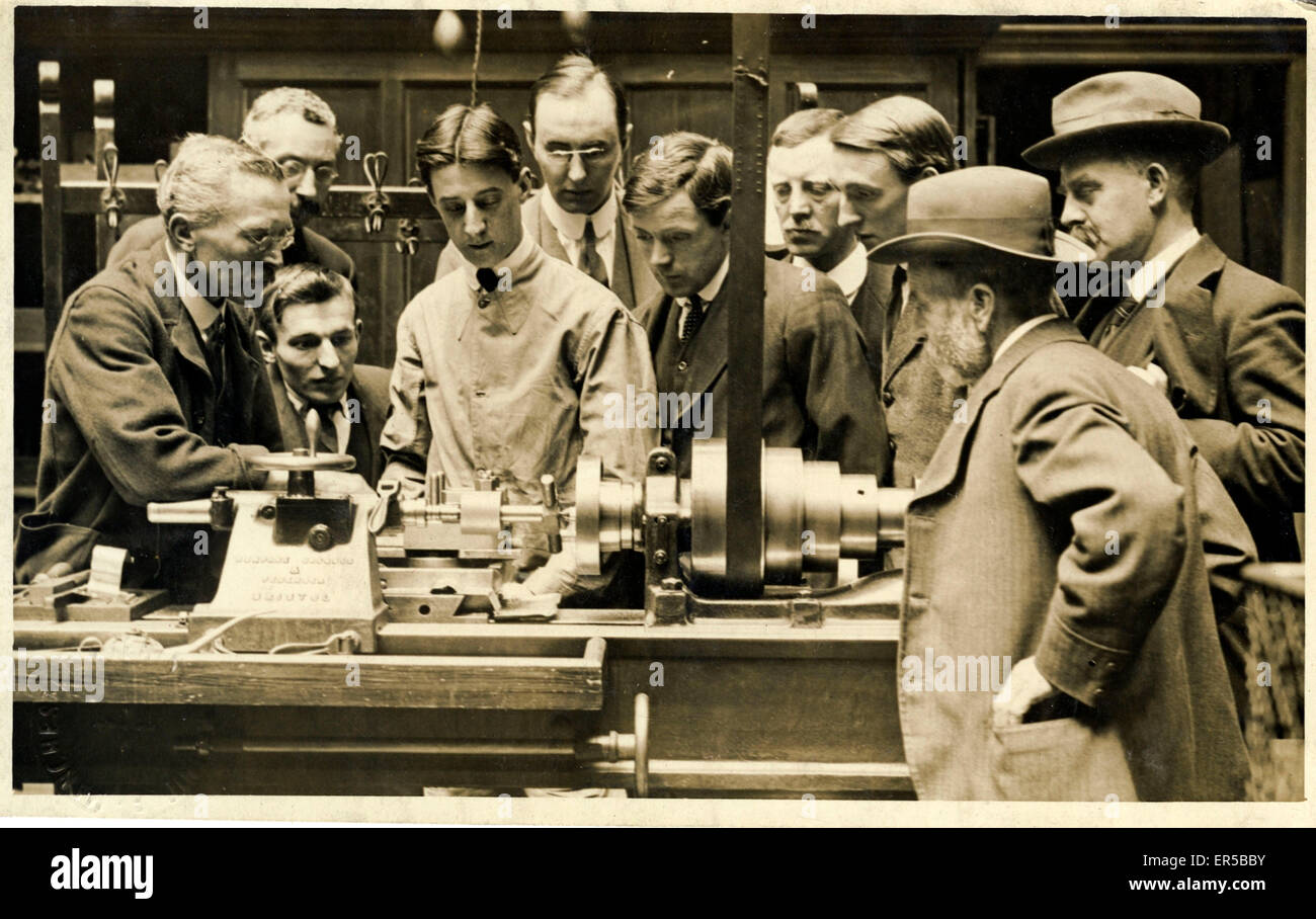 Group of Men Gathered Around a Bristol-made Metalwork Lathe, Unknown Location, .  1910s - Stock Image