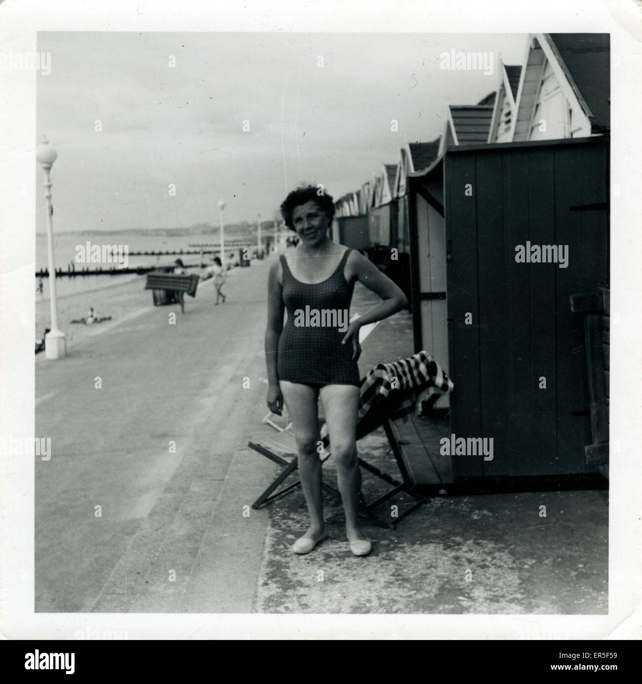 Holidaymaker, Boscombe, near Bournemouth, Dorset, England. Showing Beach Huts  1950s - Stock Image