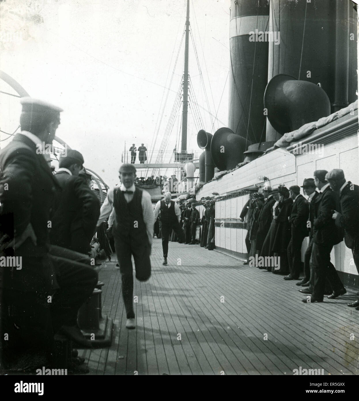 Victorians Racing on Deck of Ship, England.  1890s - Stock Image