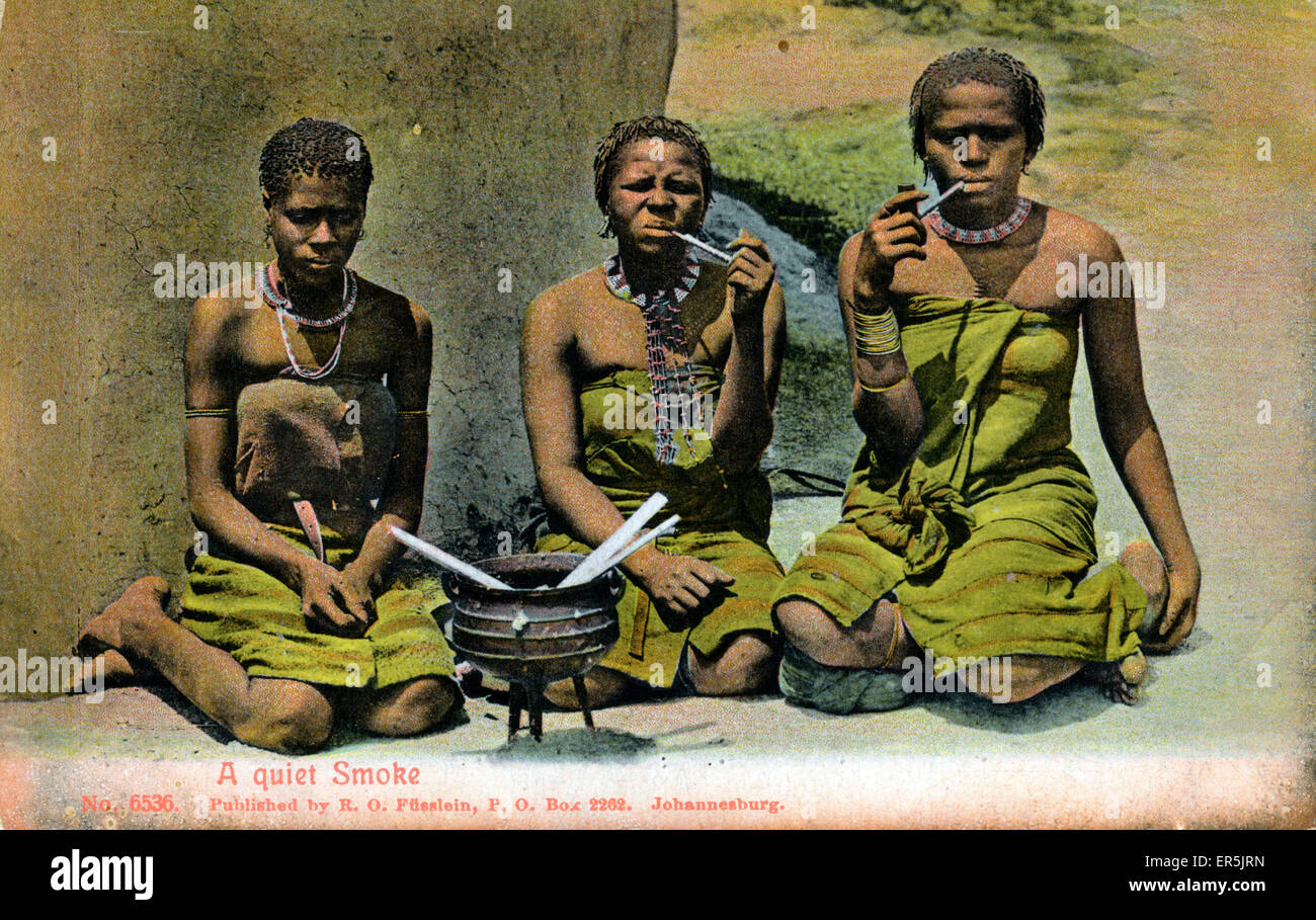 Native South Africans in Traditional Dress, South Africa. Captioned 'A Quiet Smoke'  1900s - Stock Image