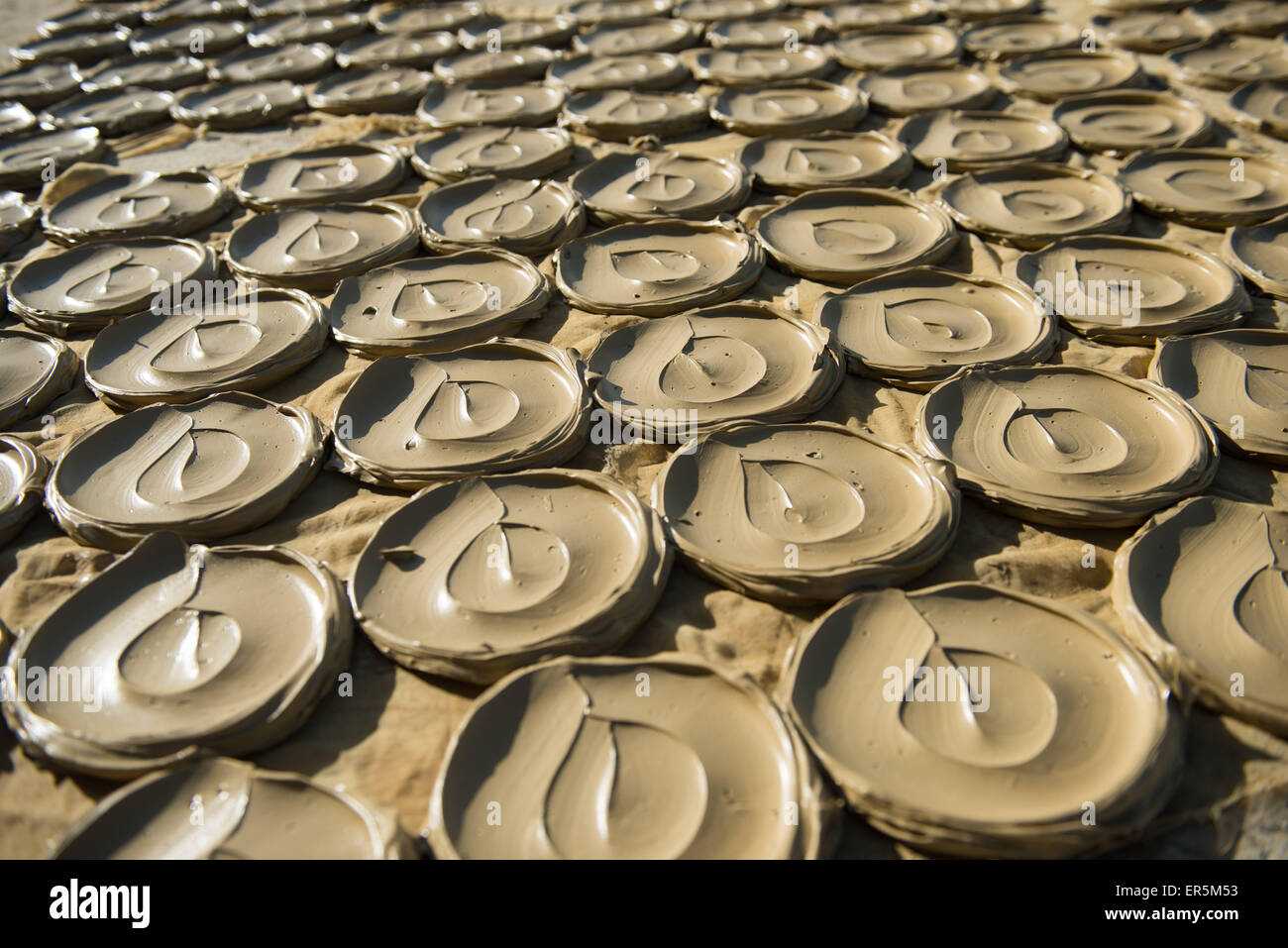 (150528) -- PORT AU PRINCE, May 28, 2015 (Xinhua) -- Mud cookies are placed on the ground in the city of Port au - Stock Image