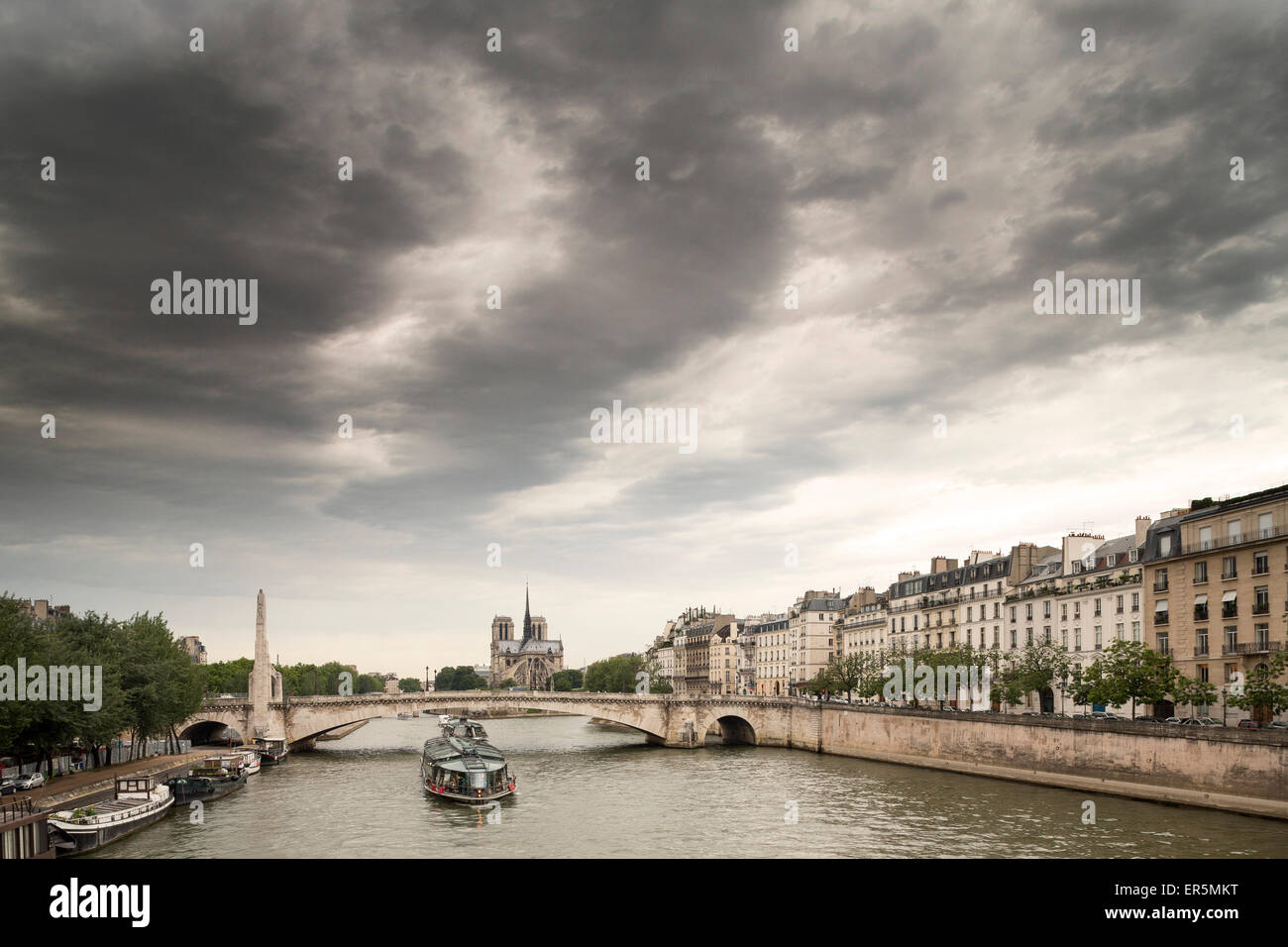 View from Pont de Sully to Pont de la Tournelle and Quai Bethune, Ile Saint-Louis, Paris, France, Europe, UNESCO - Stock Image