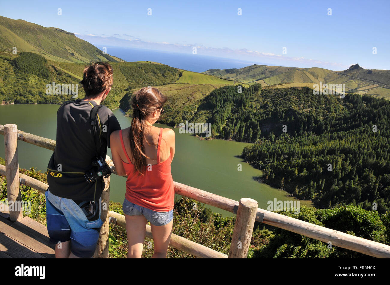 Young couple enjoying the view, Caldeira Funda, Island of Flores, Azores, Portugal Stock Photo