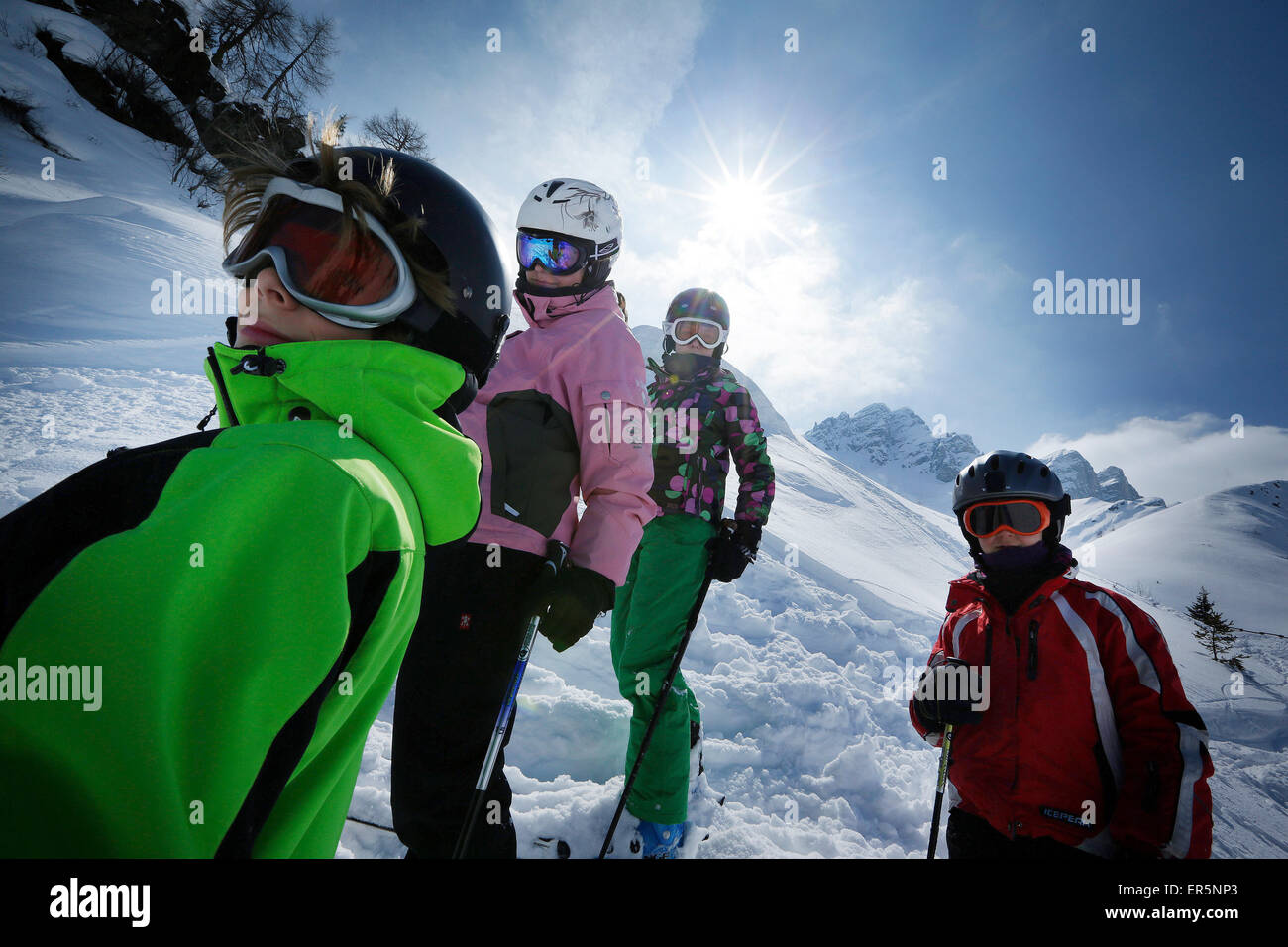 Four children wearing skiwear in snow, ski resort Ladurns, Gossensass, South Tyrol, Italy - Stock Image