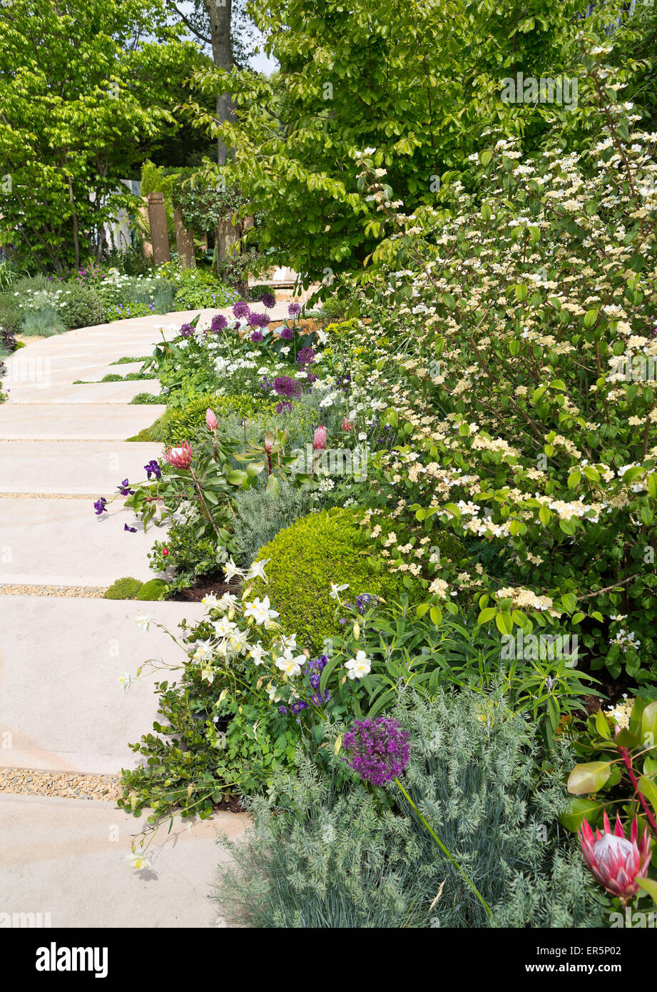 The 'Time In Between' garden, designed by Charlie Albone, Silver-Gilt medal winner at the RHS Chelsea Flower - Stock Image