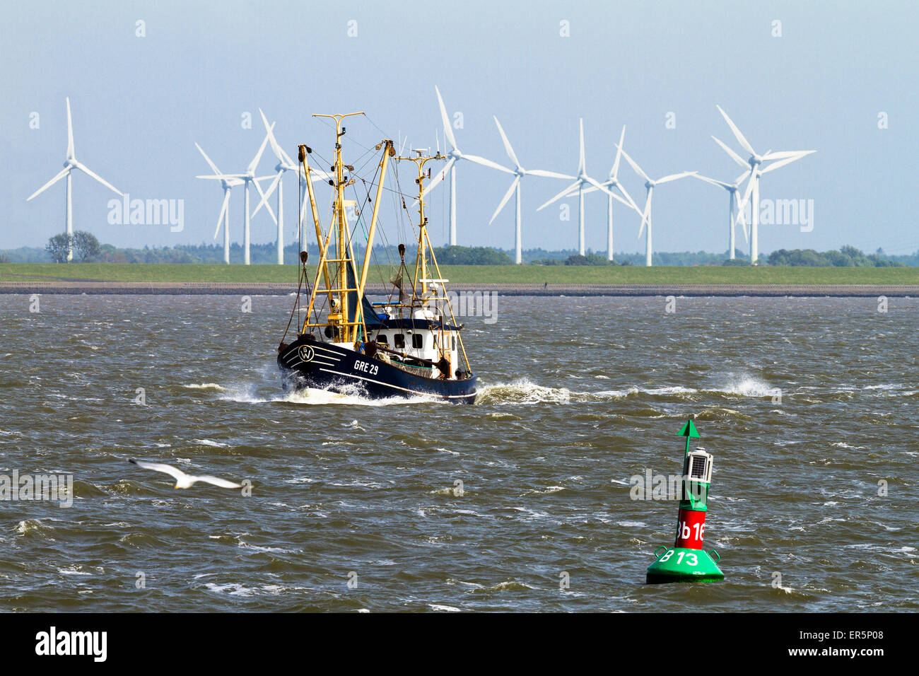 Fishing boat and wind power plant, North Sea, East Frisian Islands, East Frisia, Lower Saxony, Germany, Europe - Stock Image