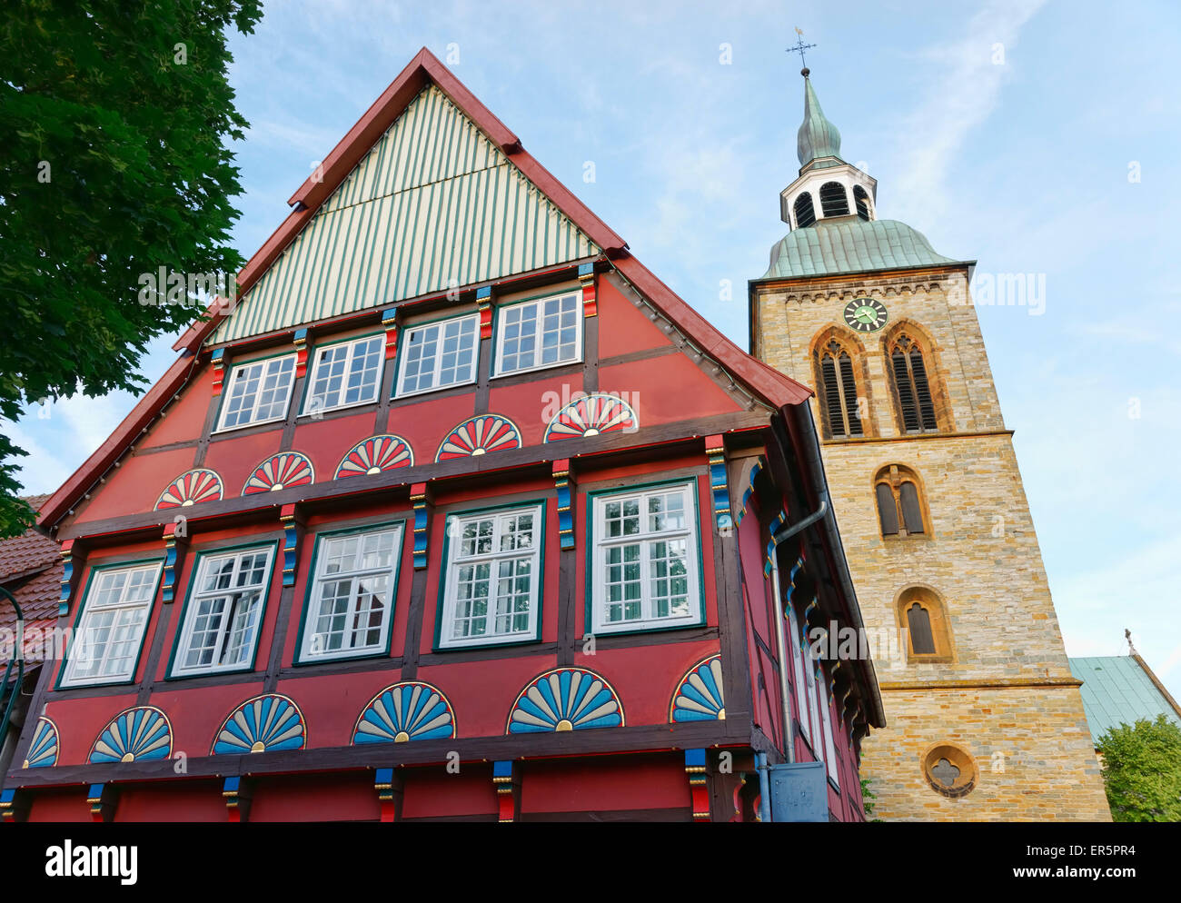 Half-timbered house and Saint Aegidius church, Rheda-Wiedenbrueck, North Rhine-Westphalia, Germany - Stock Image