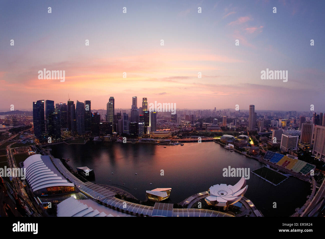 View over Marina Bay to skyline at night, Downtown core, Singapore Stock Photo