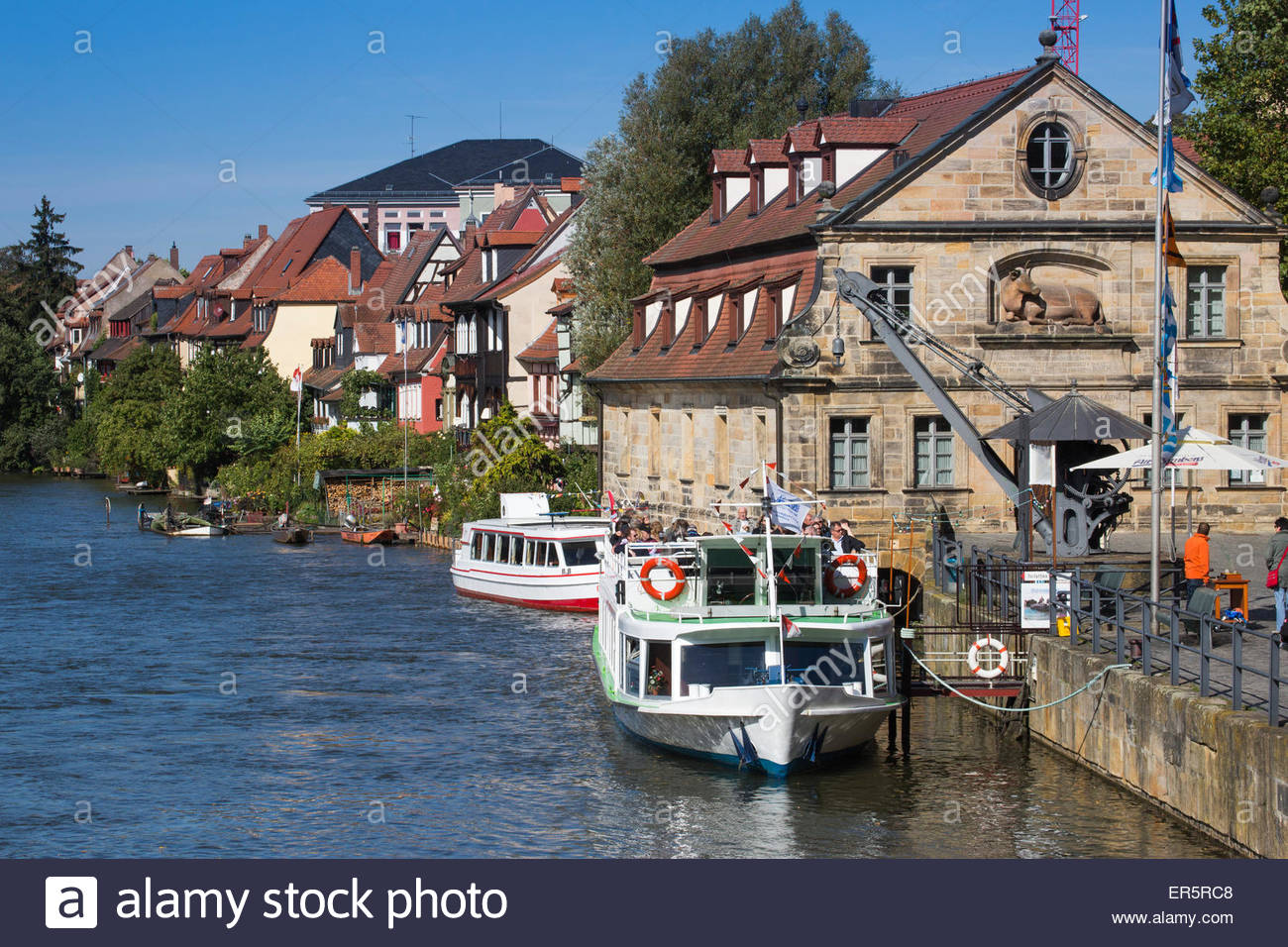 Sightseeing boat Christl and buildings of Klein Venedig Little Venice district alongside the left branch of the - Stock Image