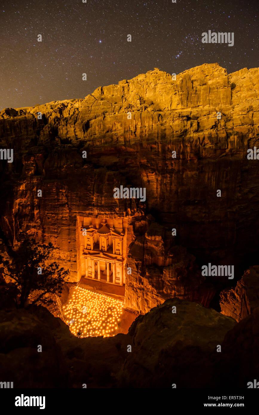 Al Khazneh in candlelight, Petra, Jordan, Middle East - Stock Image