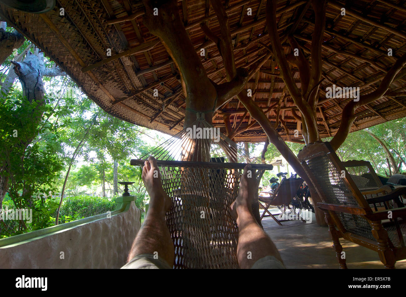 Resting in a hammock, view of feet, Beauties of Nature, small lodge next to Yala National Park, Kirinda in the South - Stock Image