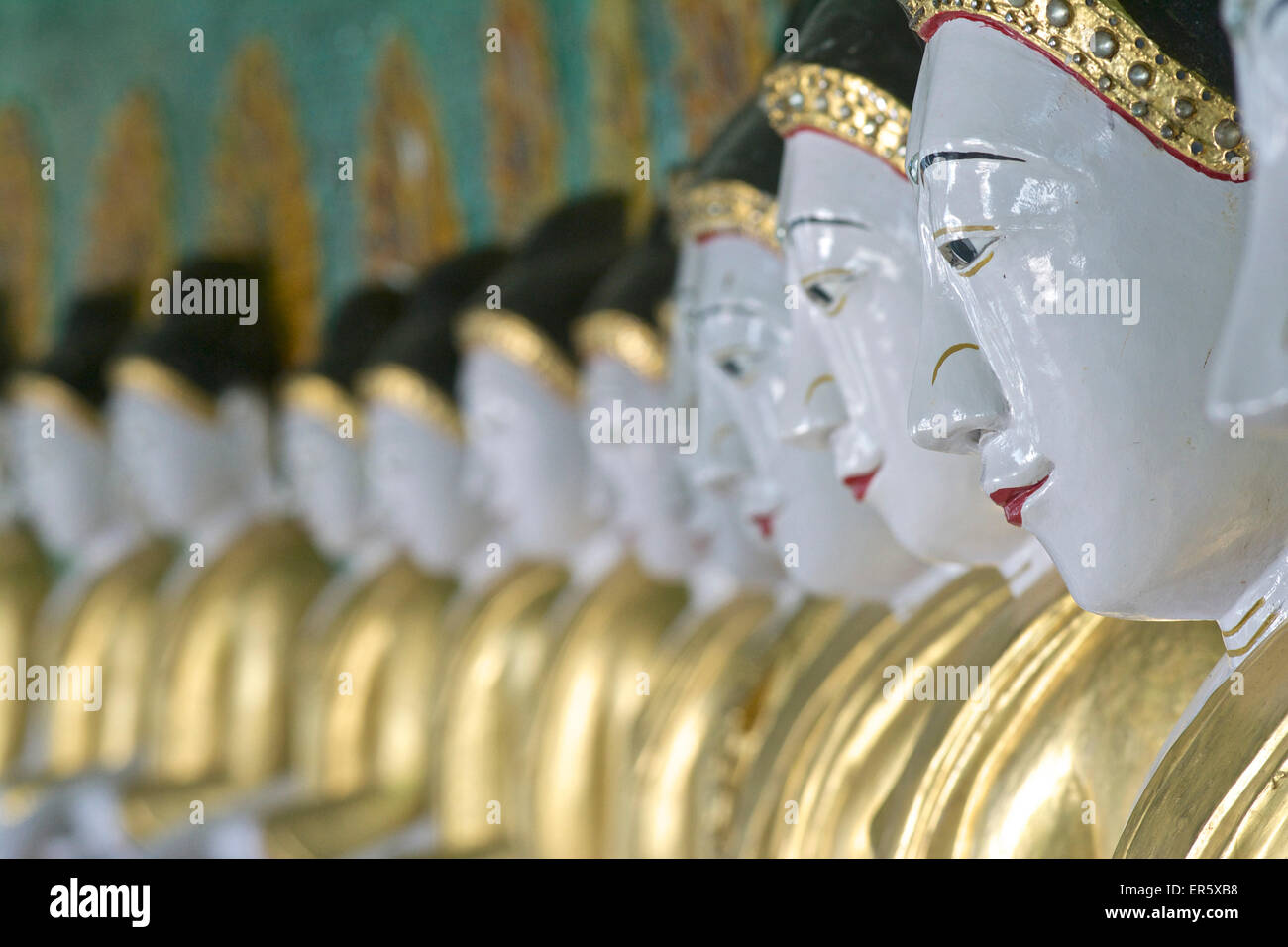 Buddha statues in the Oohmin Thonze pagoda, Sagaing Hill on the banks of the Irrawaddy river, 20km from Mandalay, Stock Photo