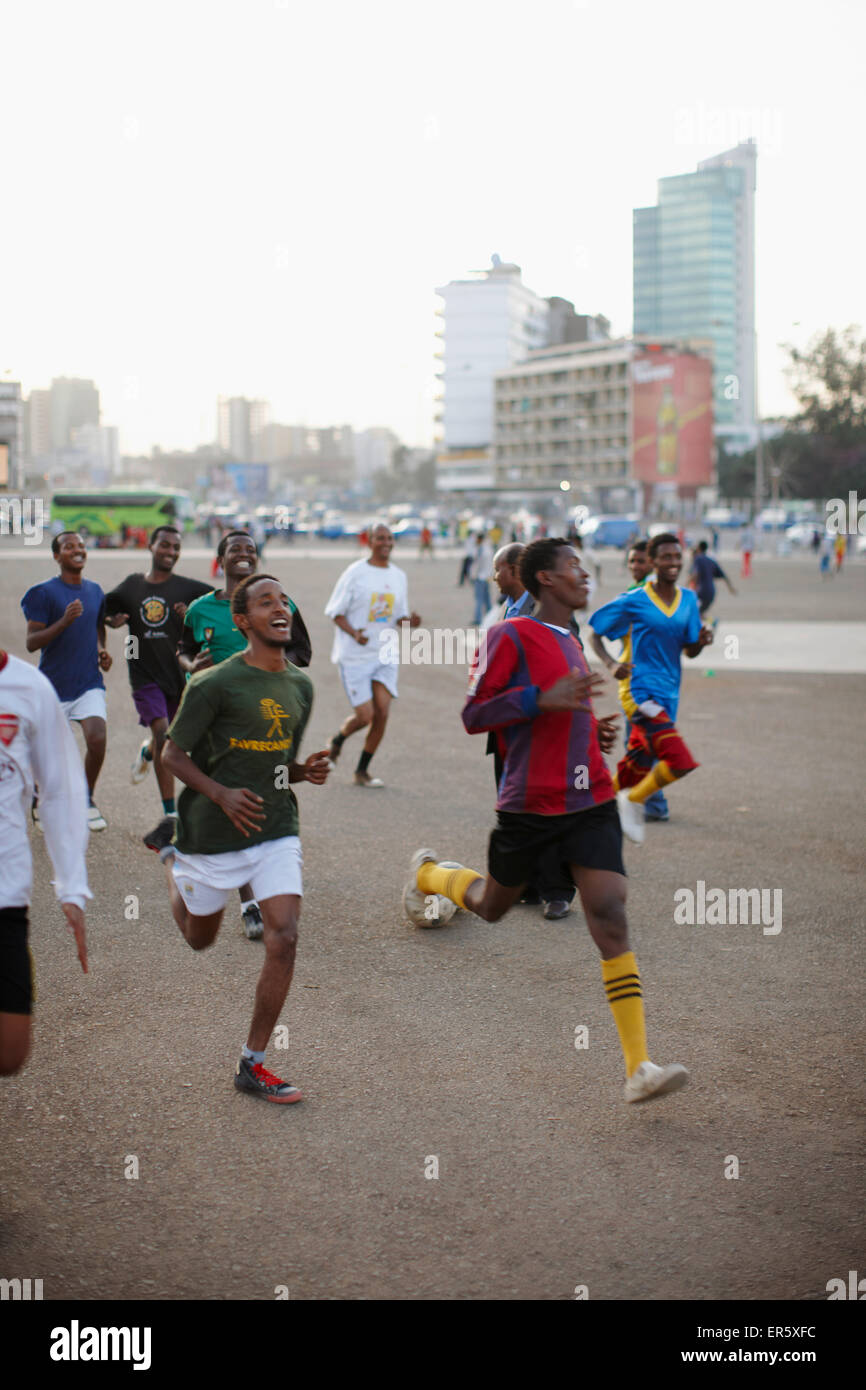 Football players at Masqal Square in the evening, Addis Ababa, Ethiopia - Stock Image