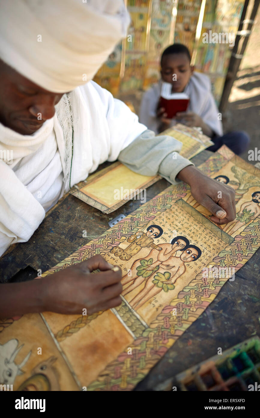Priest painting and writing biblical scenes in Geez on goatskin, Bet Giyorgis, Church of St. George, Lalibela, Amhara - Stock Image