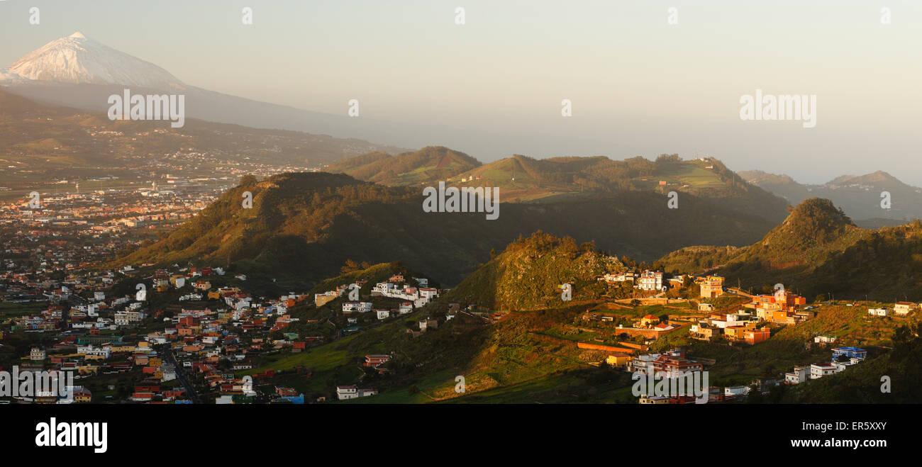 view from Mirador La Jardina, viewpoint, village Las Mercedes and San Cristobal de La Laguna, Teide mountain with - Stock Image