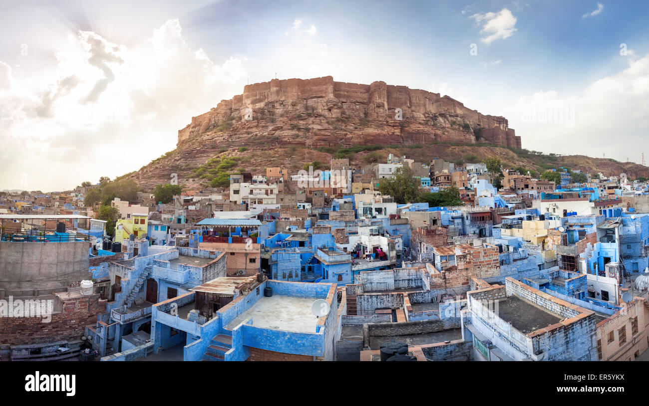 Blue city and Mehrangarh fort on the hill at sunset sky in Jodhpur, Rajasthan, India - Stock Image