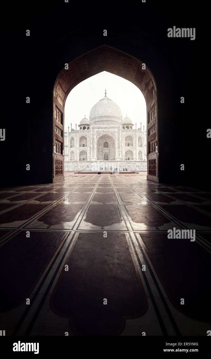 Taj Mahal view in black arch silhouette from the mosque in Agra, Uttar Pradesh, India - Stock Image
