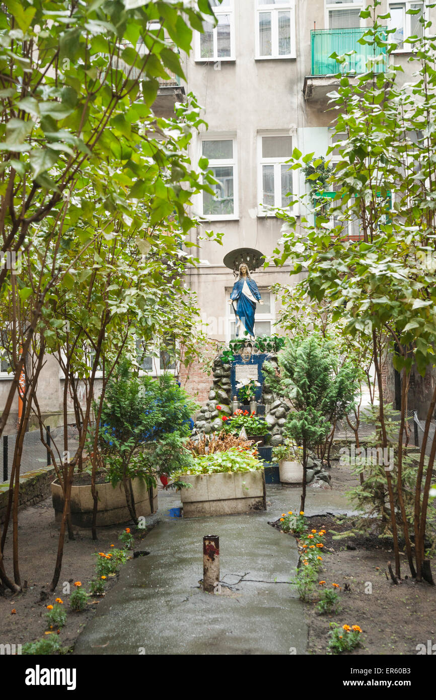 Shrine in courtyard of apartment building, left over from war, Praga district,  Warsaw, Poland, Europe - Stock Image