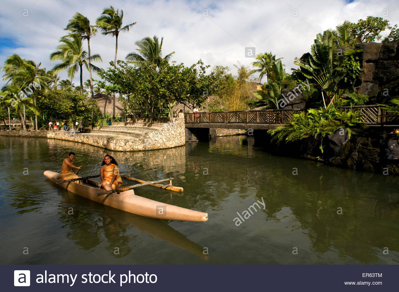 Canoe navigating the canal running through the park. Polynesian Cultural Center. Oahu. Hawaii. Polynesian Cultural - Stock Image