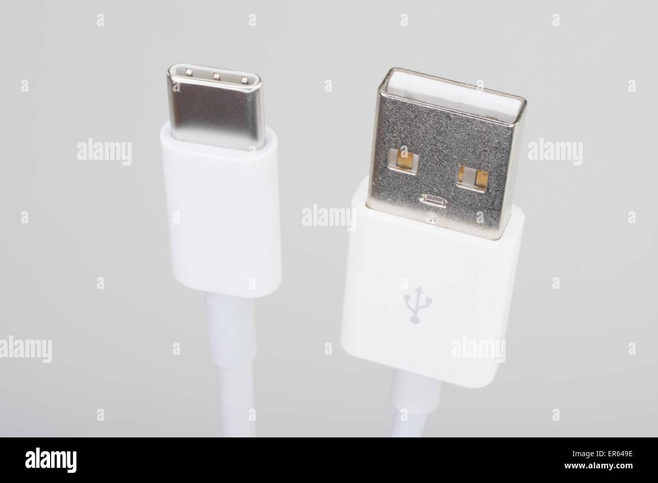 Apple USB-C USB type C connector and standard A USB plug - Stock Image