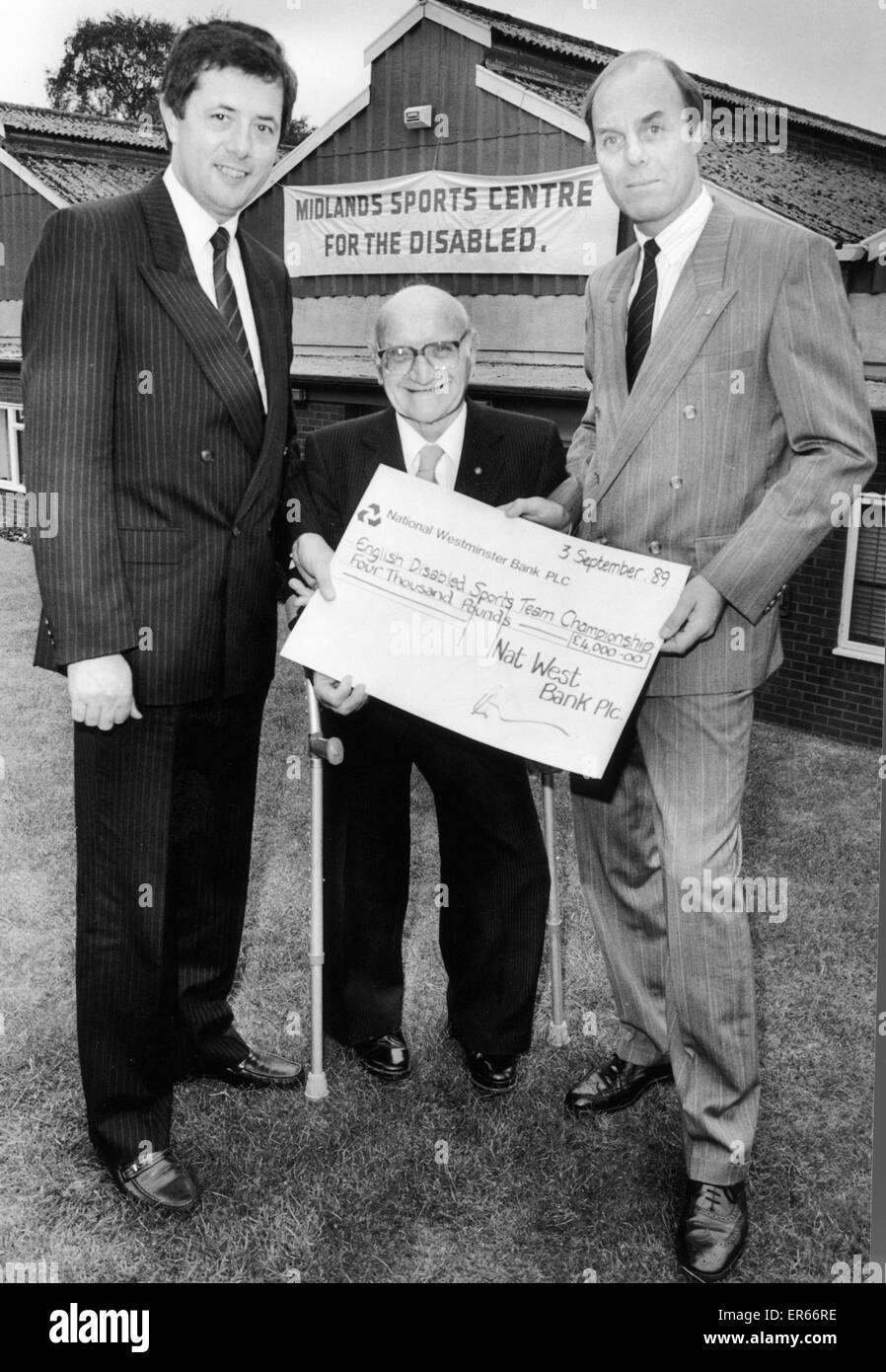 Len Tasker Coventry Disabilites campaigner and sportsman (centre) seen here with Peter Nelson (left) and Ron Gibbs - Stock Image