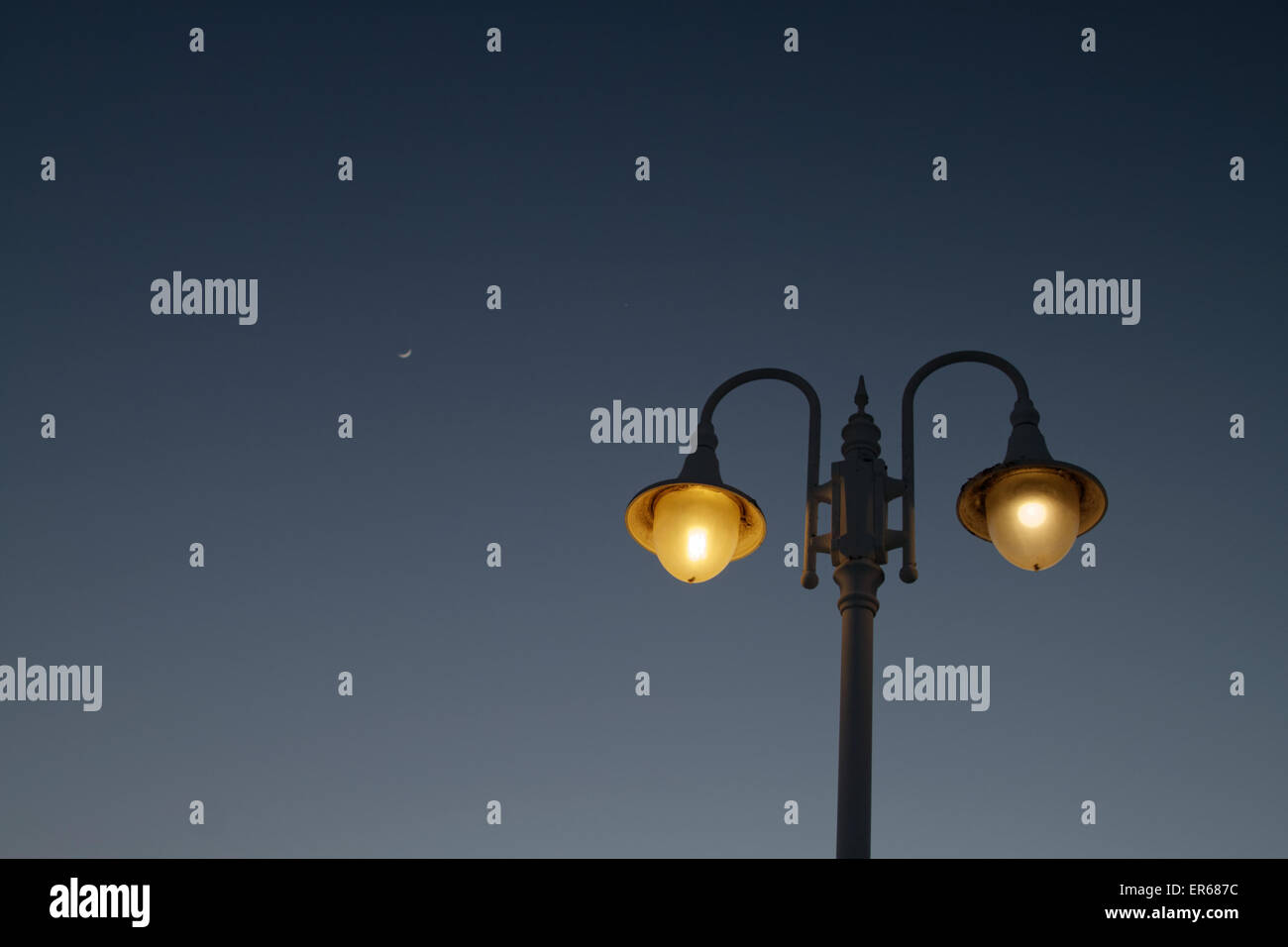 lamp post and moon - Stock Image