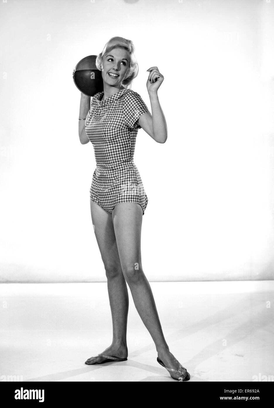 48205480932 Clothing: Fashion: Beachwear: Woman wearing check swimming costume. Model:  Felicity Fosdick