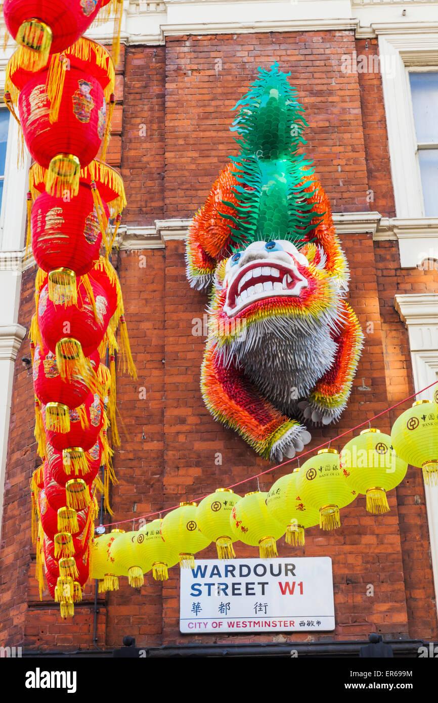 England, London, Soho, Chinatown, Wardour Street, Chinese Lion on Building Facade - Stock Image