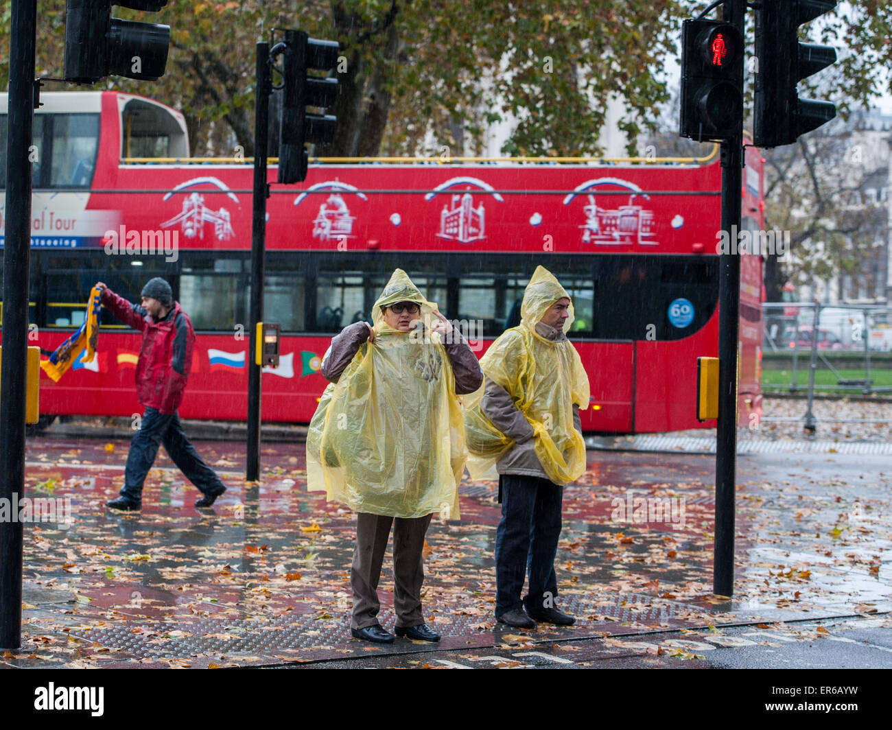 Two tourists wearing water proof ponchos in London's Parliament Square  Featuring: Atmosphere Where: London, - Stock Image