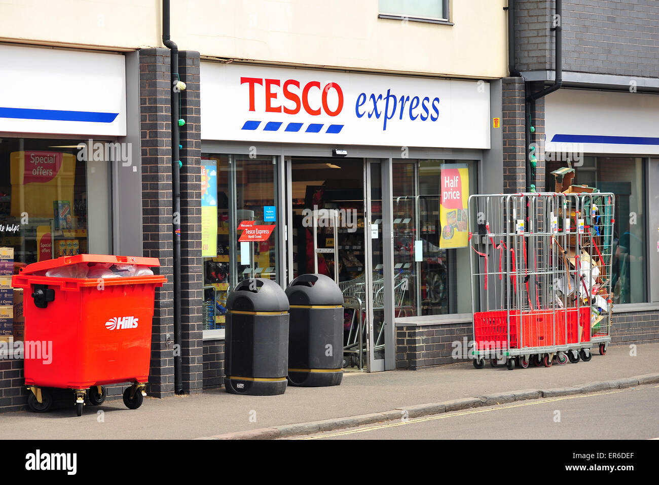 Bristol, UK. 28th May 2015 A bin of waste outside a Tesco Express supermarket in Bristol. After the French councillor - Stock Image